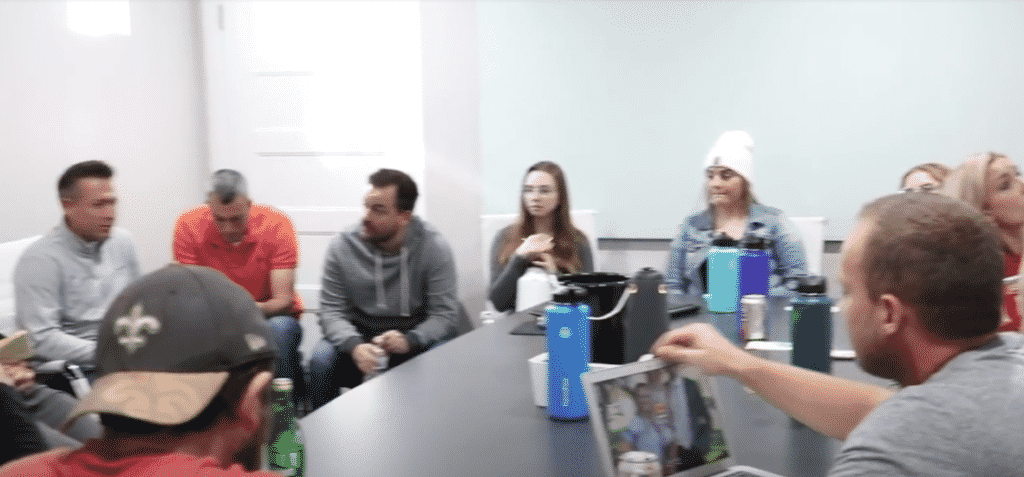a group of people in an office